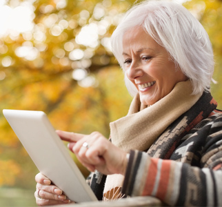 Older woman looking at e-tablet