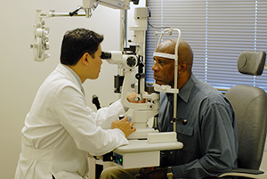Patient being examined by optometrist.