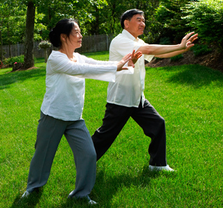 Woman and man doing tai chi